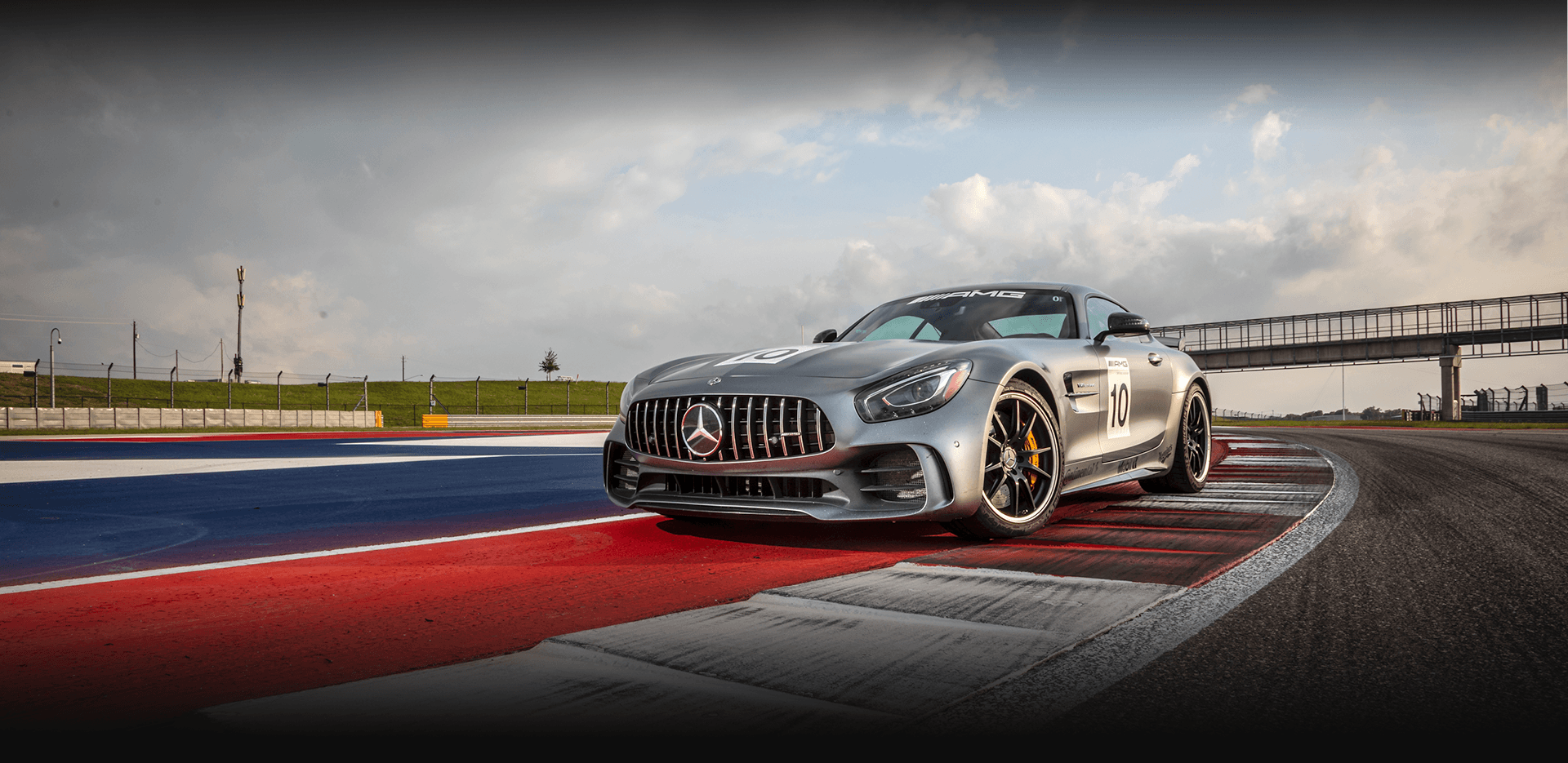 Gray Mercedes-AMG vehicle parked on rumble strip at Circuit of the Americas