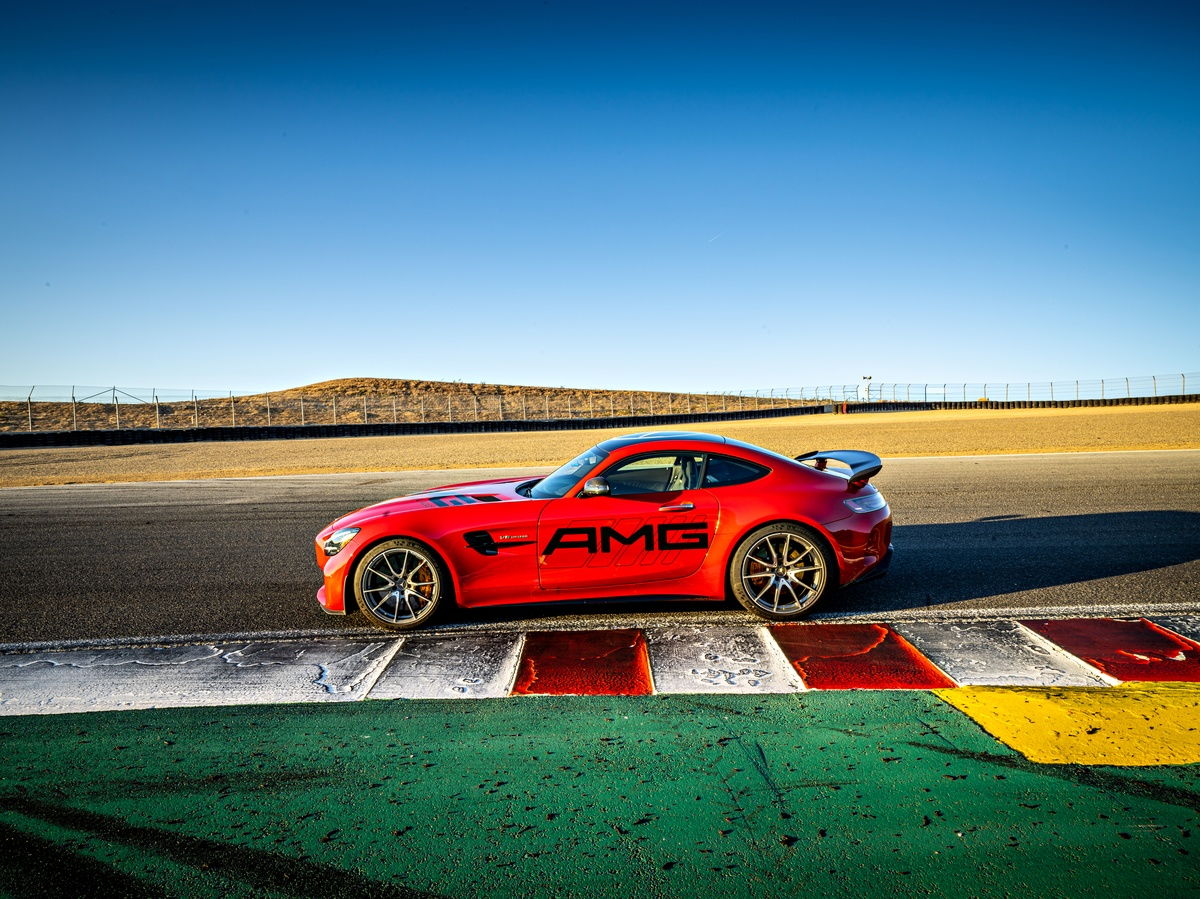 Red Mercedes AMG Vehicle parked on Laguna Seca Raceway from side view