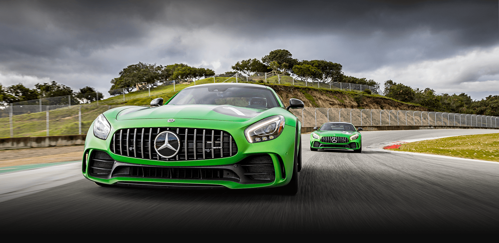 Two green Mercedes AMG Vehicles on Laguna Seca Raceway in Salinas, CA