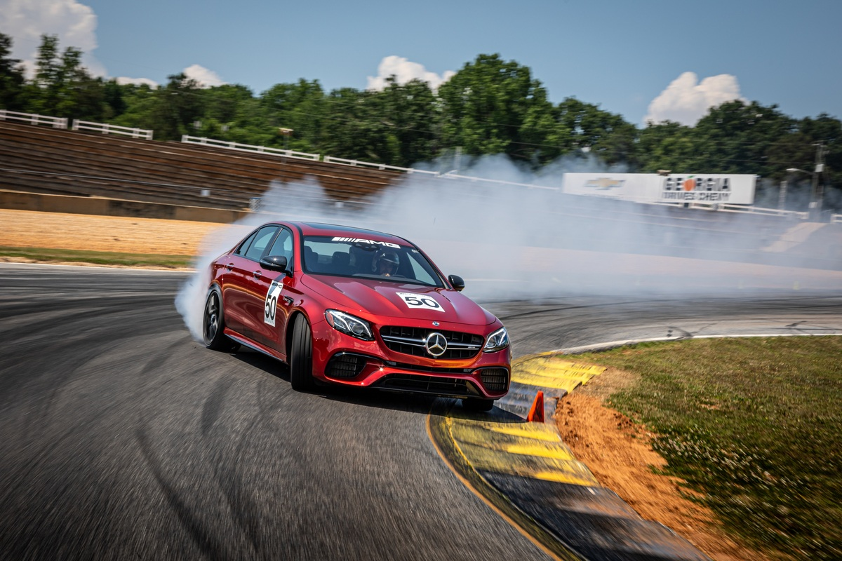 Red Mercedes-AMG vehicle drifting on Road Atlanta track