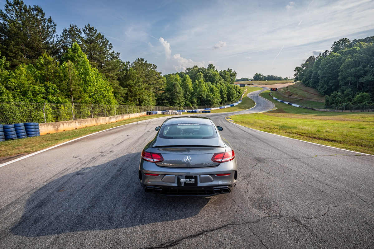 Silver Mercedes-AMG vehicle viewed from back overlooking Road Atlanta track