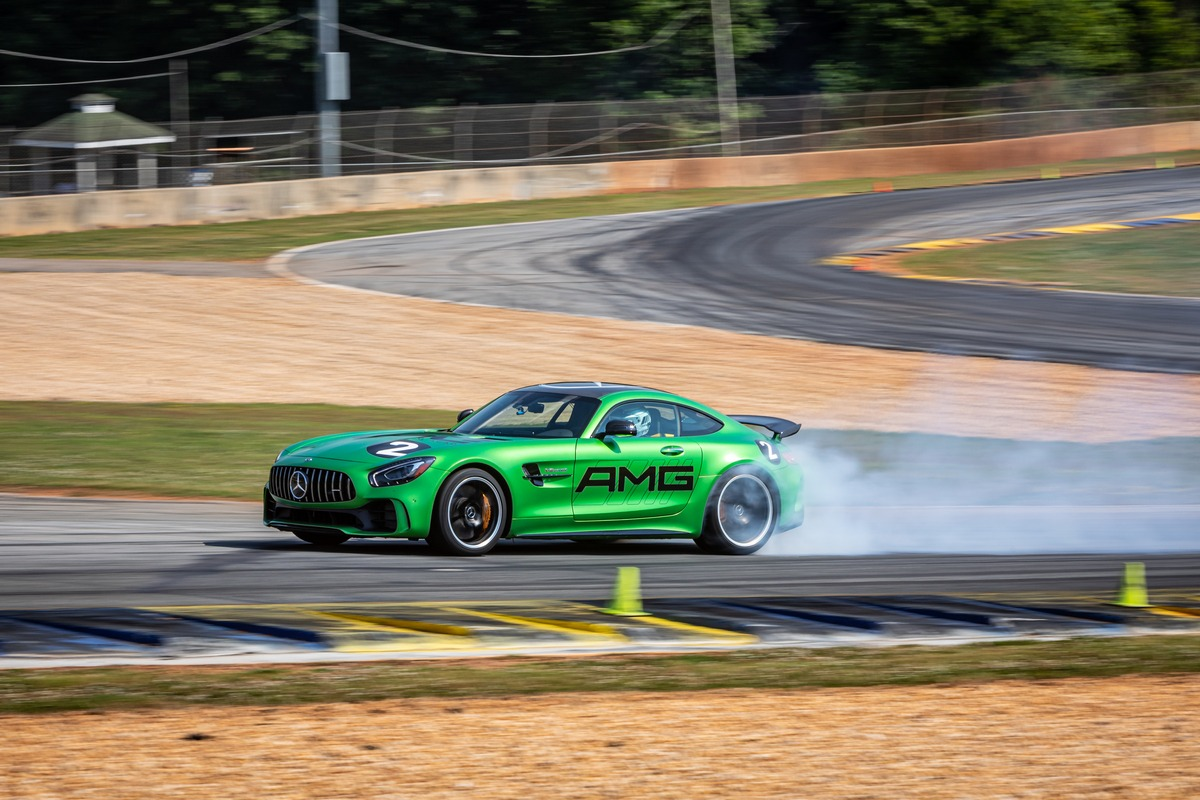 Green Mercedes-AMG vehicle drifting on Road Atlanta track